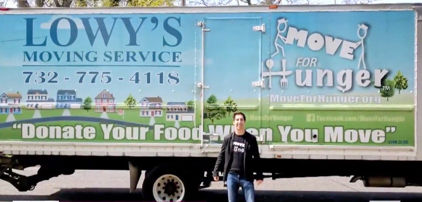 man standing in front of delivery truck