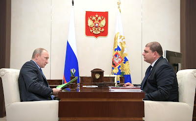 Vladimir Putin and Orel Region Governor Vadim Potomsky.
