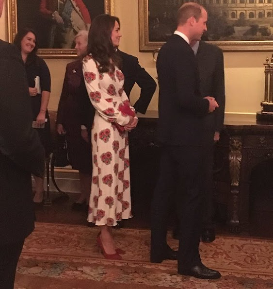 Queen Elizabeth, Prince William, Catherine, Duchess of Cambridge, Prince Harry, Princess Anne and Prince Edward. Kate Middleton wore Alexander McQueen Silk Floral Midi Dress