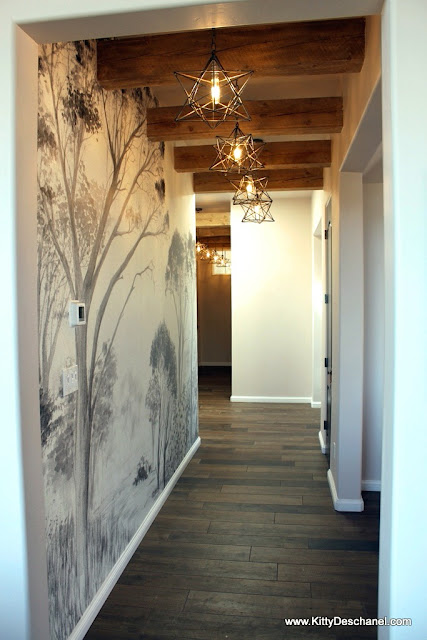 moravian star lights hallway with wallpaper