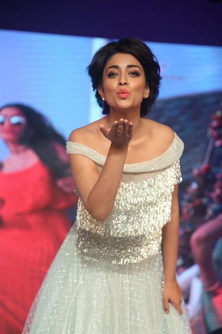 Shriya Saran Stills At Nakshatram Movie Audio Launch In White Dress