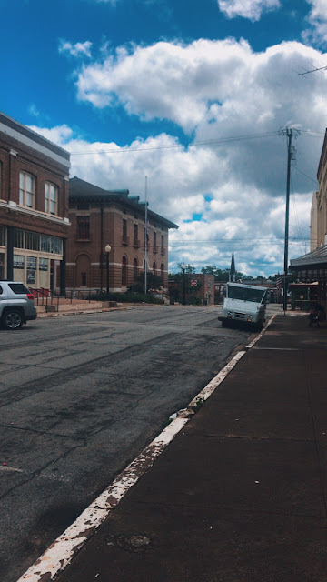View down old main street in small town.
