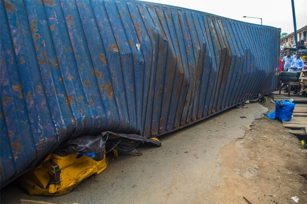 [Photos]Container Truck Falls On And Crushes Keke Napep