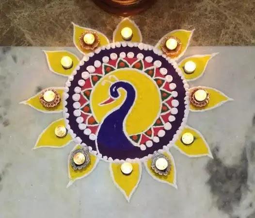 peacock rangoli design with diya