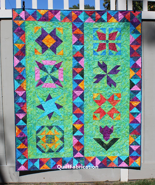 colorful batik quilt with 8 different blocks