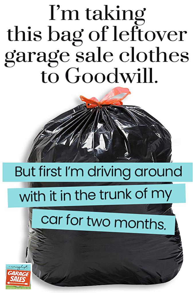 Trash bag full of leftover garage sale clothes