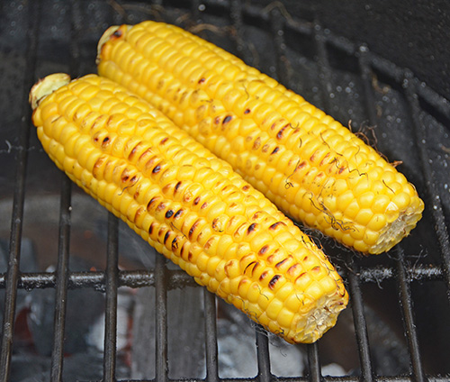 Fire roasting corn on a kamado grill like Big Green Egg, Primo, Vision or Grilla Kong