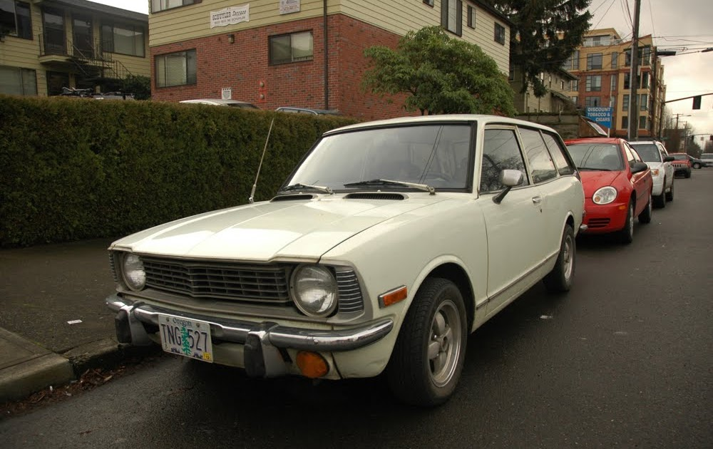 OLD PARKED CARS.: 1973 Toyota Corolla Station Wagon and Jason.