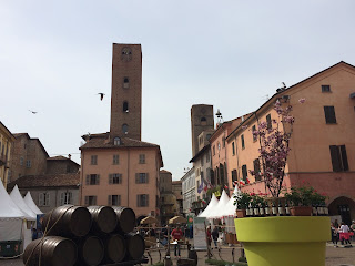 Large wine barrels form part of a display in Piazza Duomo, one of the main squares in Alba's historic centre