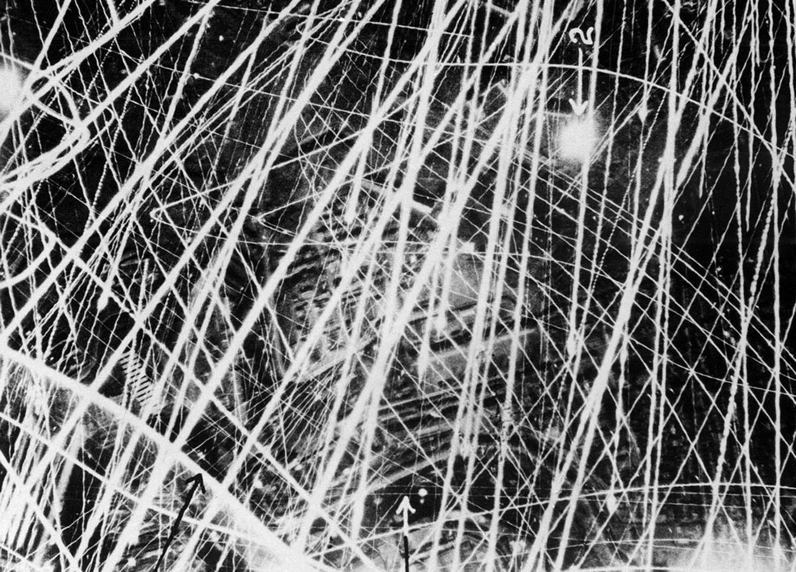 This photograph was taken on January 31, 1941, during a nigthtime air raid carried out by the Royal Air Force above Brest, France. It gives a graphic impression of what flak and anti-aircraft fire looks like from the air. In the period of three to four seconds during which the shutter remained open, the camera clearly captured the furious gunfire. The fine lines of light show the paths of tracer shells, and the broader lines are those of heavier guns. Factories and other buildings can be seen below.