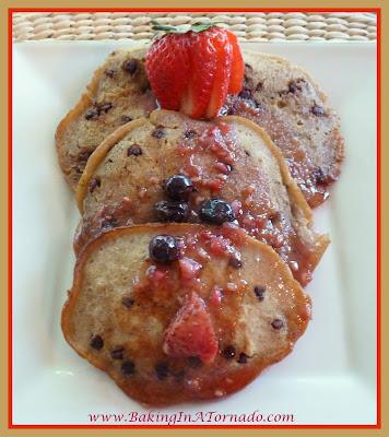 Hazelnut Coffee Pancakes with Berry Syrup | recipe developed by www.BakingInATornado.com | #recipe #breakfast