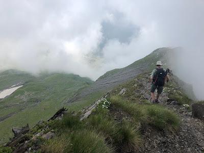 ust over the Passo di Valsecca and heading toward Bivacco Frattini (orange structure in photo).