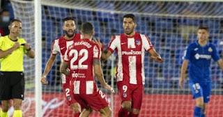 قاد النجم الأوروغوياني لويس سواريز أتلتيكو مدريد للفوز 2-1 على مضيفه خيتافي