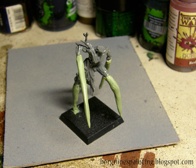 WIP photo of the conversion of a Sylvaneth Dryad, showing first, thick and uneven application of milliput and greenstuff on the limbs