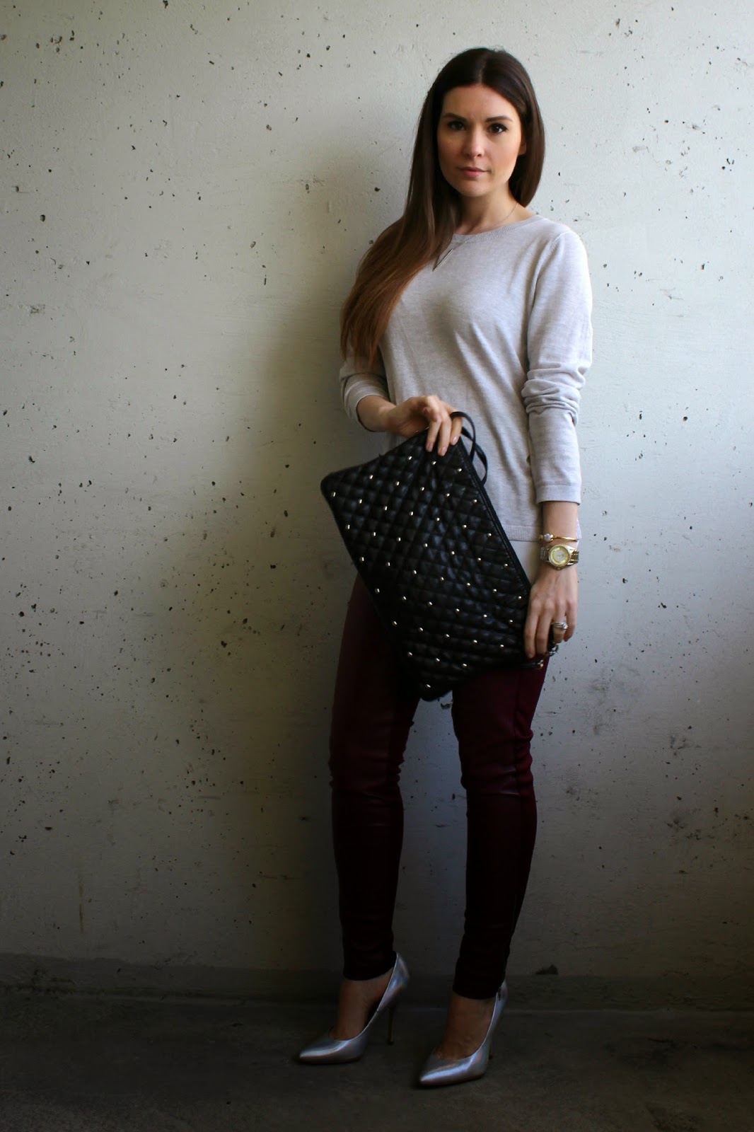 Grey Sweater, red pleather pants and a black crossbody bag