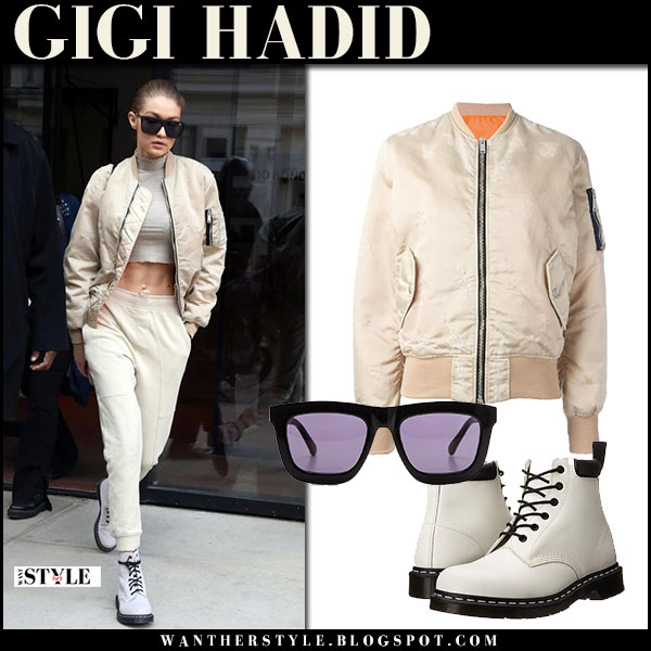 Gigi Hadid in cream satin bomber jacket unravel, cream sweatpants and white army boots dr martens 939 what she wore street style
