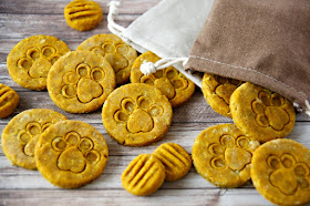 Pumpkin dog treats stamped with a paw print design