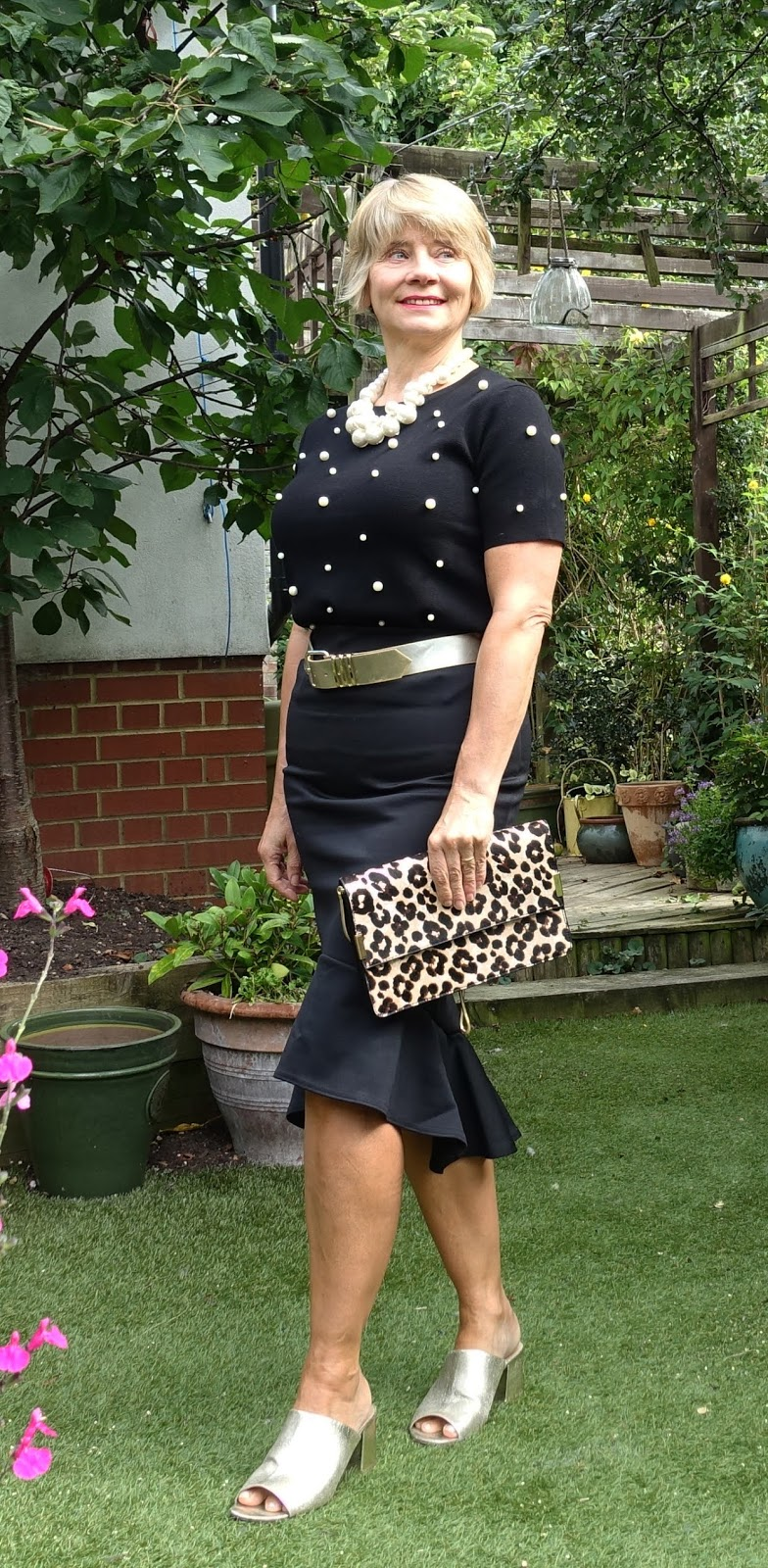 Gail Hanlon from Is This Mutton, the style blog for the over-50s, showing her signature style touches of plenty of pearls, black and a metallic bet