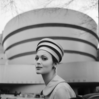 woman wearing hat resembling the Guggenheim museum in front of the Guggenheim Museum, NY, 1960