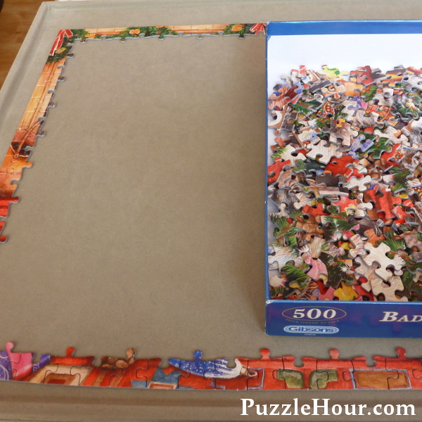 Finished edge piece of a 500 piece jigsaw puzzle Bad Cats & Baubles by Debbie Cook