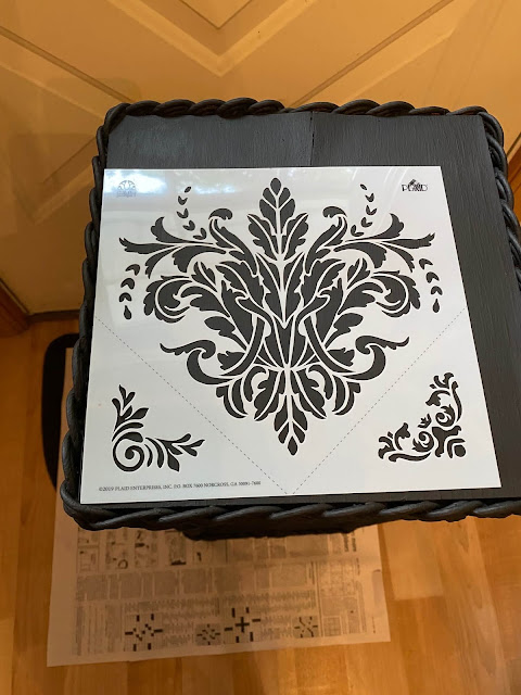 Photo of a scrolly stencil on top of a painted plant stand