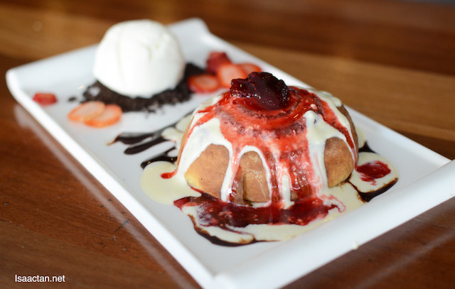 Cinnamon Roll with Berries and Ice Cream.