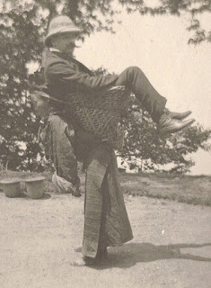 carrying a white master on his back, a picture that shows the barbaric assaults on british colonies.
