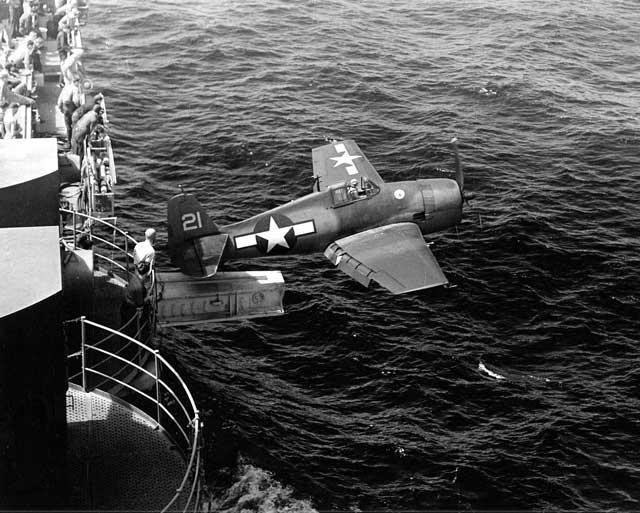 An F6F Hellcat launching from a hangar catapult on USS Hornet, worldwartwo.filminspector.com