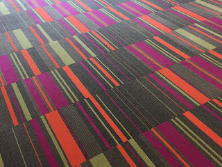 picture of orange, green and magenta carpeting