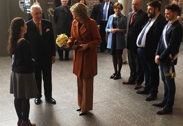 Queen Mathilde of Belgium visited the Luca School of Arts in Leuven. Queen wore Natan blouse and Natan trousers. Mathilde wore Natan coat, and earrings