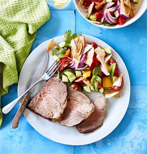 Sumac lamb roast with fattoush salad in a serving dish