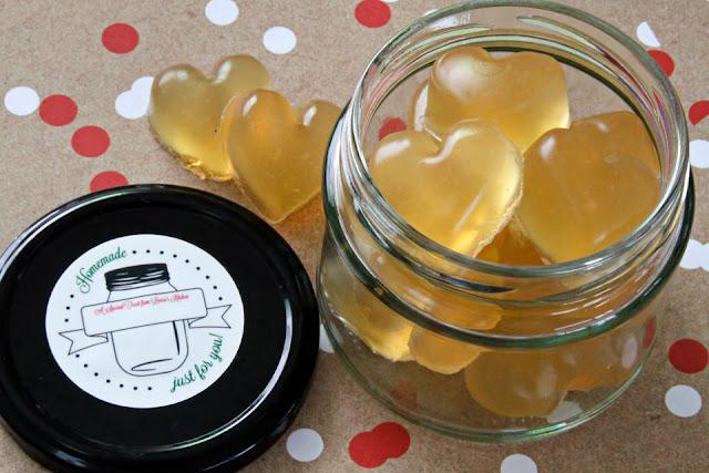 Heart shaped gelatin gummy dog treats in a glass treat jar