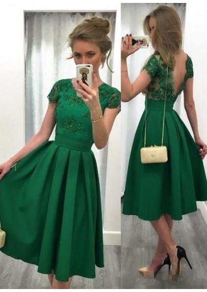 فستان سهرة اخضر اللون جذاب وفخم