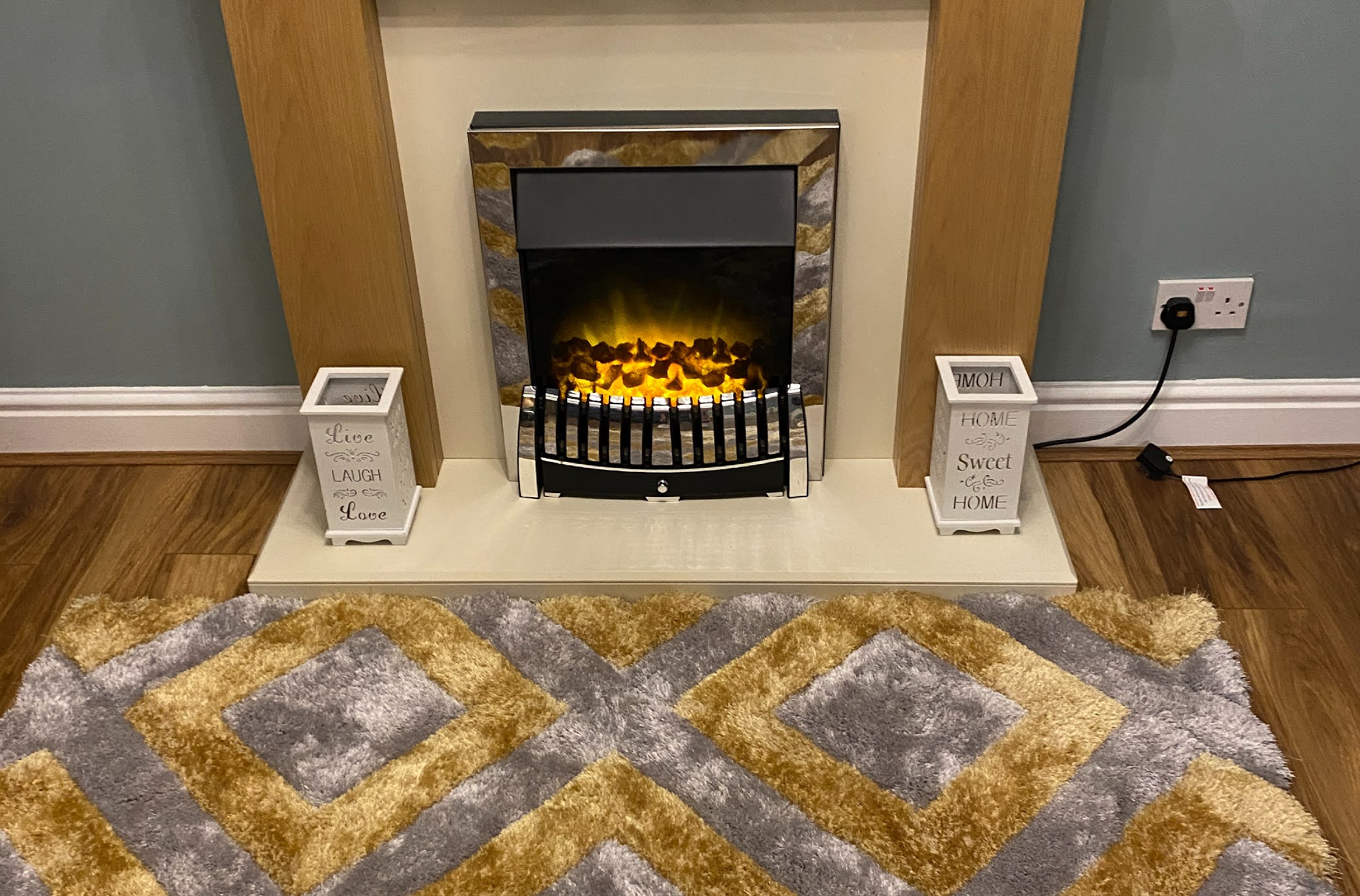 Fireplace with yellow and grey rug in front