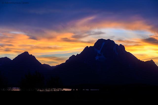 Adventurous Tastes | Purple and pink sunset over mountains