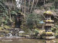 Stupa and fall - Kenroku-en Garden, Kanazawa, Japan