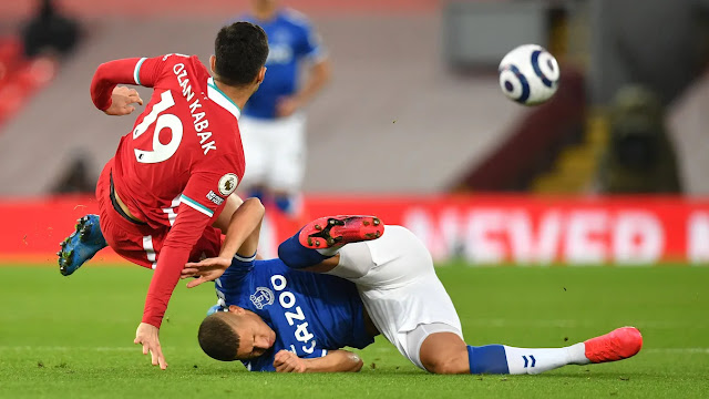 Liverpool defender Kabak tackles Everton forward Richarlison