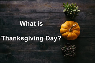 Image of pumpkin & trees with what is Thanksgiving Day text.