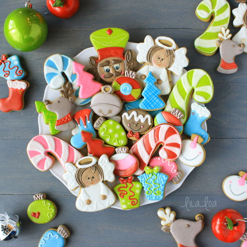 Brightly colored Christmas chocolate sugar cookies - candy canes, ornaments, gifts, and angels