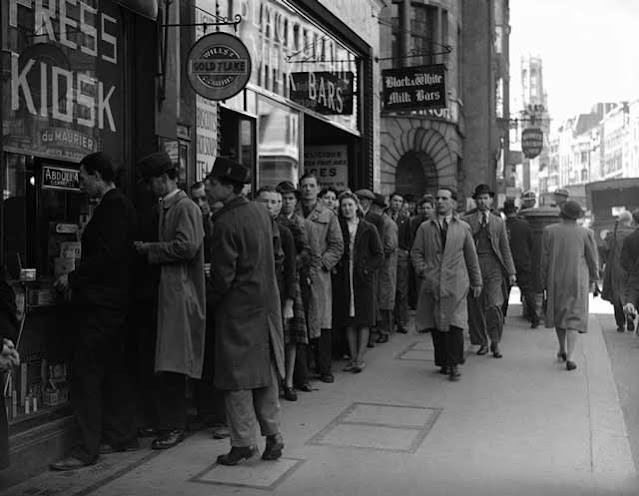 Tobacco queue in England, 15 April 1942 worldwartwo.filminspector.com