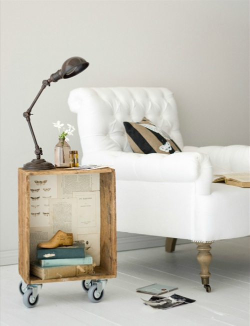 This wooden drawer adorned with vintage book pages makes a great side table.