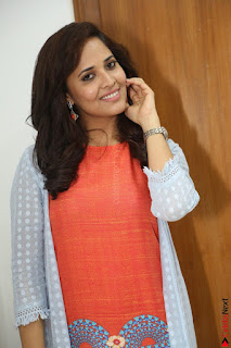 Actress Anasuya Bharadwaj in Orange Short Dress Glam Pics at Winner Movie Press Meet February 2017 (58).JPG