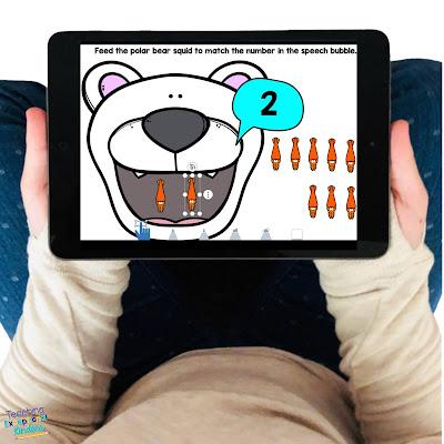 kid holding an iPad with a Seesaw activity including a polar bear