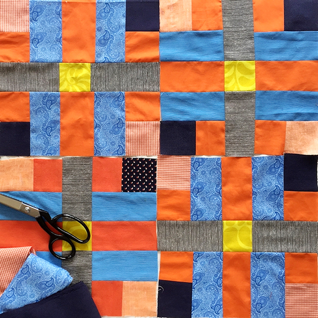 Four Lockstep quilt blocks
