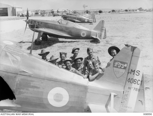 Australian troops with captured Morane-Saulnier MS.406C1 fighters, 24 July 1941 worldwartwo.filminspector.com