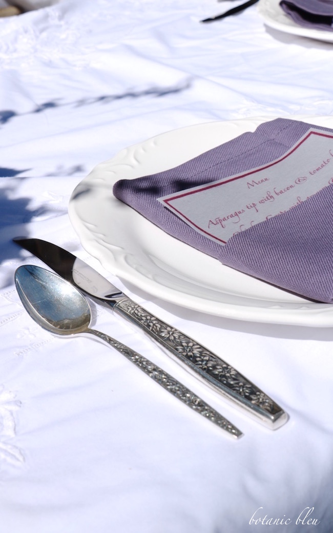 white-scalloped-plate-purple-napkin-spring-garden-party