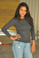 Actress Bhanu Tripathri Pos in Ripped Jeans at Iddari Madhya 18 Movie Pressmeet  0075.JPG
