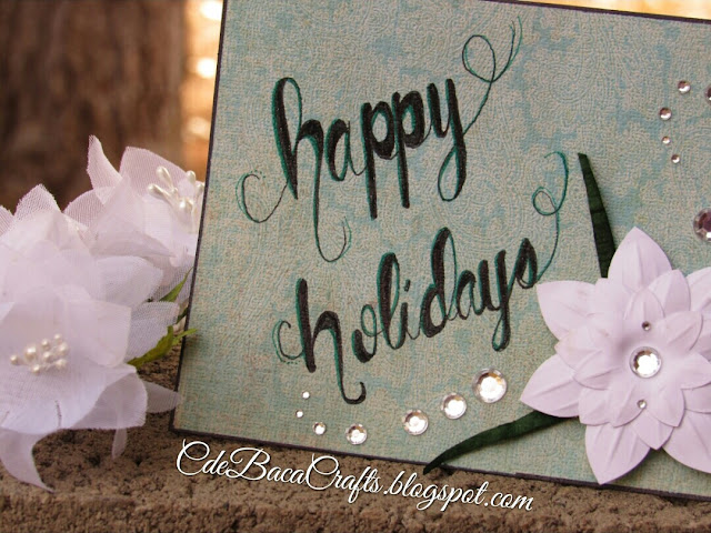 A handmade holiday card for cardmaking shown on CdeBaca Crafts blog.