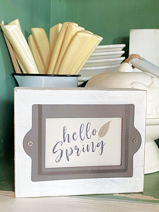 hello spring sign in the cabinet