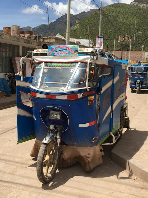 tiny motorcycle taxis in Maca, Peru